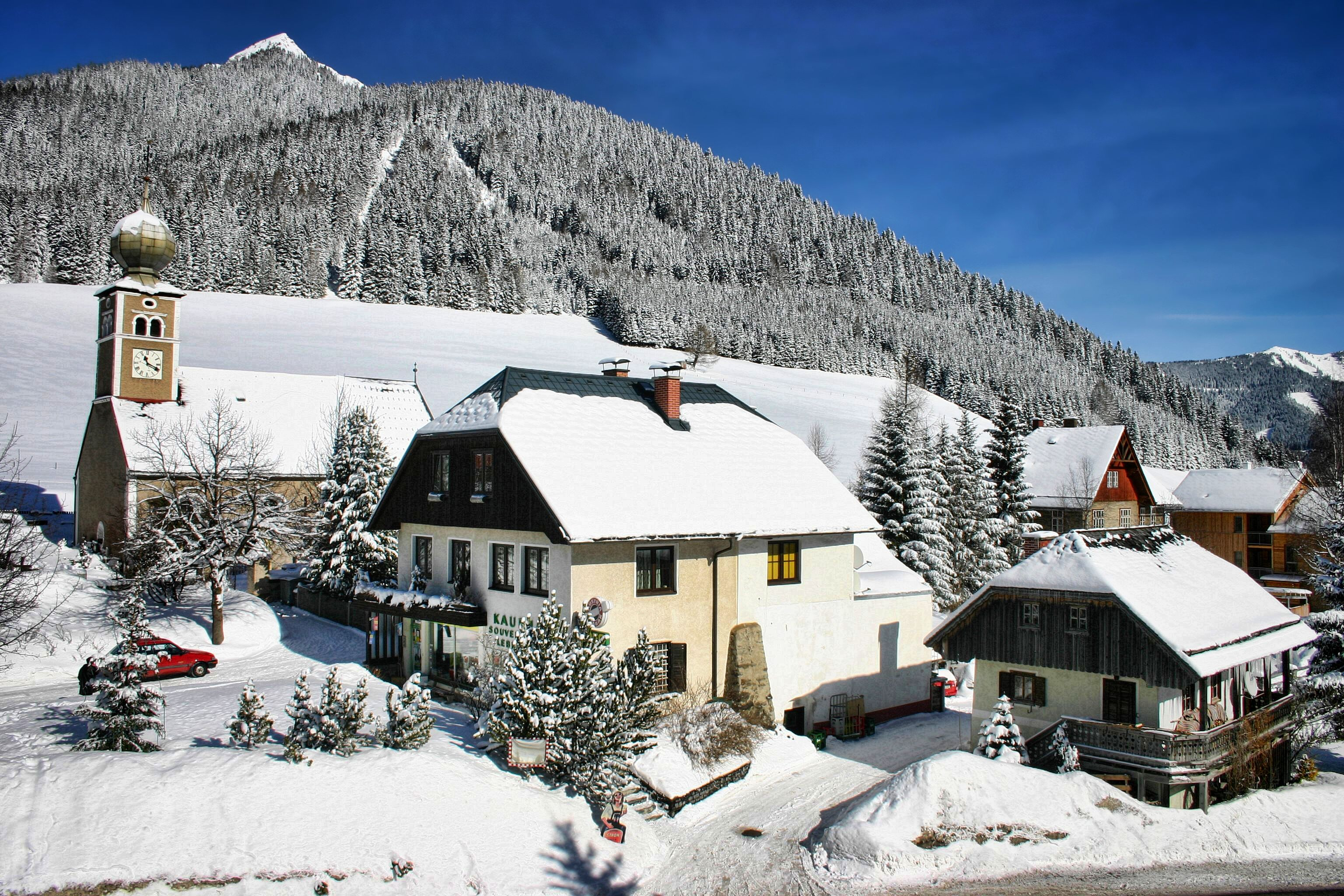 Village shop and apartments for sale in family ski resort